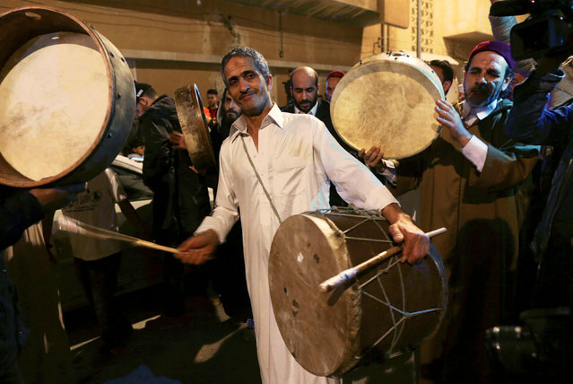 Libyan Sufi Muslims beat drums during a procession celebrating the religious holiday of Mawlid al-Nabi, the birthday of Prophet Mohammad, in Benghazi, Libya December 10, 2016. (Photo by Esam Omran Al-Fetori/Reuters)
