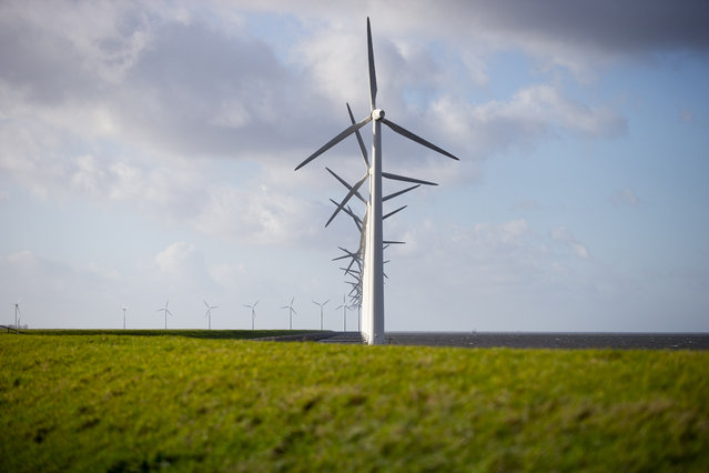 Wind turbines are seen on a dike near Urk, Netherlands, Friday, January 22, 2021. A group of scientists, including five Nobel laureates, called Friday for more action to adapt the world to the effects of climate change, drawing comparisons with the faltering response to the coronavirus crisis, ahead of a major online conference on climate adaptation starting Monday and hosted by the Netherlands. (Photo by Peter Dejong/AP Photo)