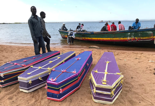Volunteers arrange the coffins containing the dead bodies of passengers retrieved after a ferry MV Nyerere overturned off the shores of Ukara Island in Lake Victoria, Tanzania on September 22, 2018. (Photo by Jackson Njehia/Reuters)
