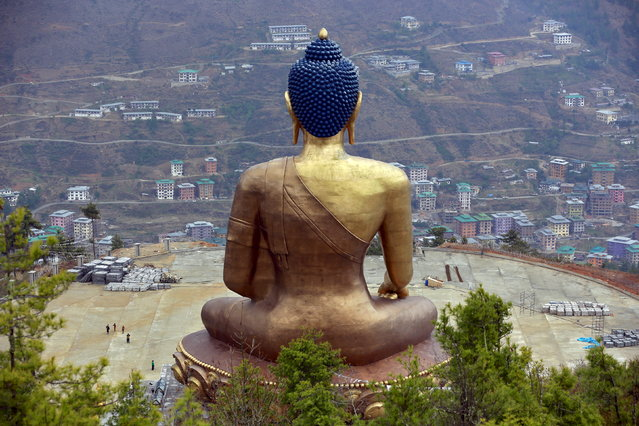 BHUTAN: The Buddha Dordenma statue overlooks the town of Thimphu, Bhutan, April 16, 2016. (Photo by Cathal McNaughton/Reuters)