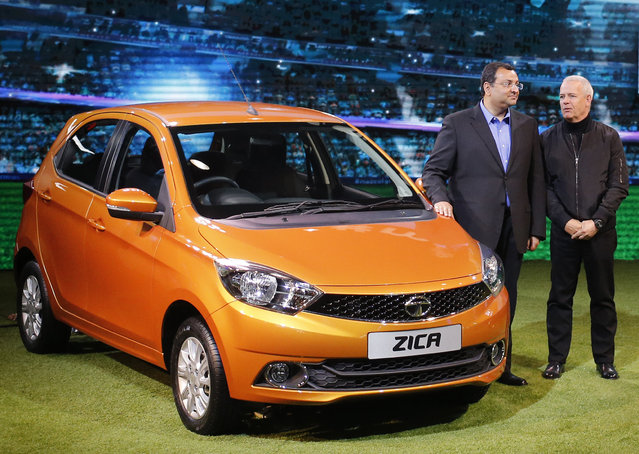 Chairman of Tata Group, Cyrus Mistry and Tata Motors' Head of Advanced and Product Engineering, Tim Leverton (R), pose with a Zica car during its launch at the Indian Auto Expo in Greater Noida, on the outskirts of New Delhi, India, February 3, 2016. Tata Motors said on Tuesday it had decided to rename its Zica, short for Zippy Car, after the mosquito-borne virus Zika was declared an international health emergency. (Photo by Anindito Mukherjee/Reuters)