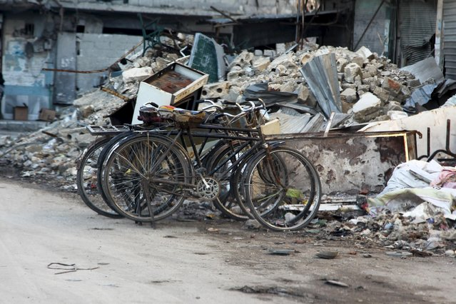 Bicycles are parked near rubble from damaged buildings in Aleppo's eastern district of Tariq al-Bab, Syria January 19, 2016. Picture taken January 19, 2016. (Photo by Abdelrahmin Ismail/Reuters)