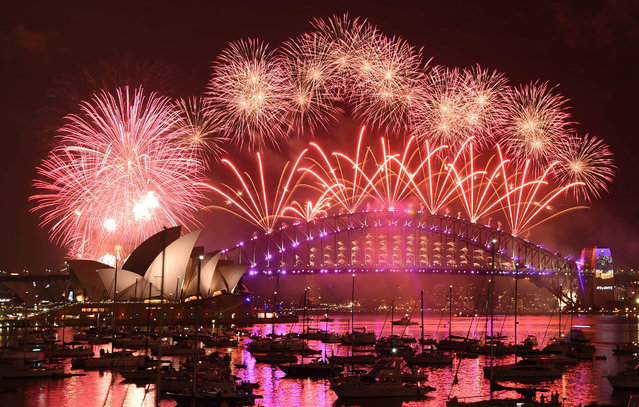 The New Year's Eve Fireworks illuminate the sky above Sydney Harbour with its Opera House and Harbour Bridge, taken from Mrs Macquarie's Point in Sydney, Australia, 31 December 2016. (Photo by Mick Tsikas/EPA)