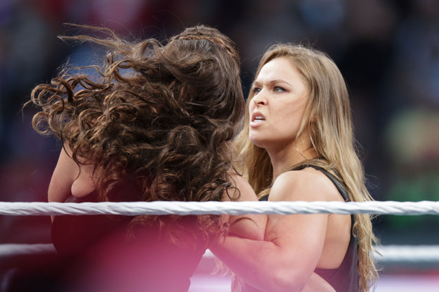 UFC fighter Ronda Rousey makes a surprise appearance at WrestleMania 31 on Sunday, March 29, 2015 at Levi's Stadium in Santa Clara, CA. WrestleMania broke the Levi's Stadium attendance record at 76,976 fans from all 50 states and 40 countries. (Photo by Don Feria/AP Images for WWE)