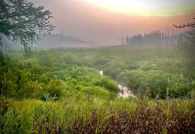 This image provided by the USDA Forest Service, shows a smoky, foggy sunrise along the Gunflint Trail on Tuesday, August 24, 2021, in Superior National Forest in northern Minnesota. Residents well to the north along the upper Gunflint Trail, a dead-end highway that's a popular jumping off spot for Boundary Waters trips, were told Monday night to stand by in case they also needed to evacuate because of wildfires. (Photo by Sarah Shapiro/USDA Forest Service via AP Photo)