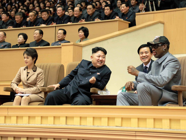 North Korean leader Kim Jong Un (2nd L) watches a basketball game between former U.S. NBA basketball players and North Korean players of the Hwaebul team of the DPRK with Dennis Rodman (R) at Pyongyang Indoor Stadium in this undated photo released by North Korea's Korean Central News Agency (KCNA) in Pyongyang January 9, 2014. (Photo by Reuters/KCNA)