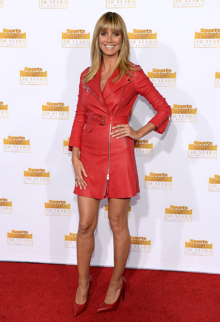 Host Heidi Klum attends NBC and Time Inc. celebrate the 50th anniversary of the Sports Illustrated Swimsuit Issue at Dolby Theatre on January 14, 2014 in Hollywood, California. (Photo by Dimitrios Kambouris/Getty Images)