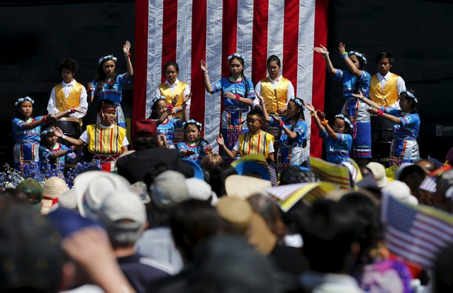Tradition Vietnamese dancing is performed as the USS Midway hosts a day-long ceremony commemorating the 40th Anniversary of Operation Frequent Wind and the fall of Saigon in San Diego, California, United States April 26, 2015. (Photo by Mike Blake/Reuters)