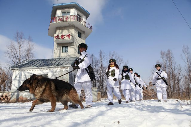 Militia members patrol alongside soldiers of China's People's Liberation Army (PLA) near a watch tower in temperatures below minus 20 degrees Celsius (minus 4 degrees Fahrenheit) in Heihe, Heilongjiang Province, China, March 1, 2016. (Photo by Reuters/Stringer)