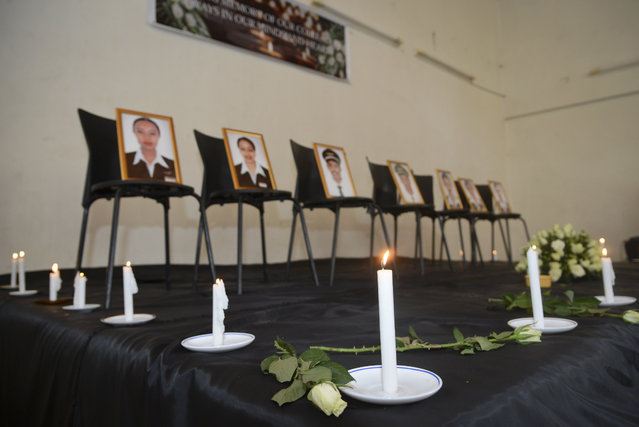 Framed photographs of seven crew members are displayed at a memorial service held by an association of Ethiopian airline pilots, in Addis Ababa, Ethiopia Monday, March 11, 2019. Authorities in Ethiopia, China and Indonesia grounded all Boeing 737 Max 8 aircraft Monday following the crash of an Ethiopian Airlines jetliner that killed 157 people, and investigators found the flight recorders from the field where the plane went down. (Photo by Samuel Habtab/AP Photo)