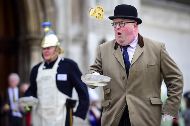 Participants take part in the Inter-Livery Pancake Race, organised by the Worshipful Company of Poulters, at the Guildhall yard on Shrove Tuesday raising funds for the Lord Mayor's Charity on March 5, 2019 in London, UK. All competitors have some association with the making of pancakes, for example the livery of Poulters supply the eggs, essential in the making of the pancakes. (Photo by Stephen Chung/London News Pictures via ZUMA Wire)