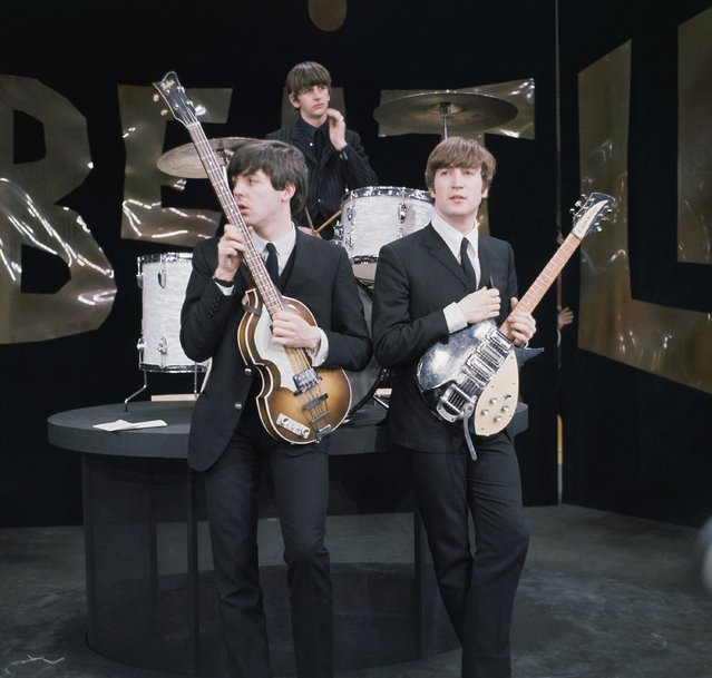 "British rock band the Beatles are shown during rehearsals on the set of the ""Ed Sullivan Show"" in New York, February 9, 1964. On drums is Ringo Starr, bassist is Paul McCartney, left, and guitarist is John Lennon.  (Photo by AP Photo)"