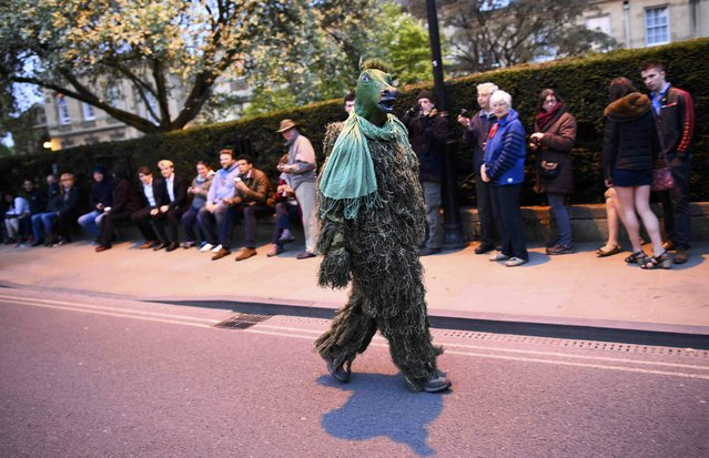 A reveller in fancy dress walks through the streets in the early hours during traditional May Day celebrations in Oxford, Britain, May 1, 2015. (Photo by Dylan Martinez/Reuters)