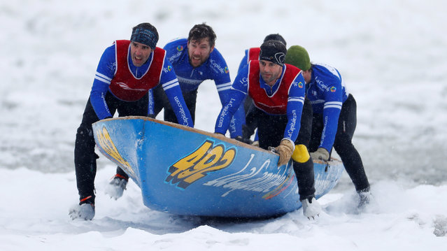 Team La Capitale competes during the Ice Canoe race at the Quebec Winter Carnival in Quebec City, February 5, 2017. (Photo by Mathieu Belanger/Reuters)