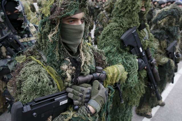 Snipers of Ukraine's National Guard attend an opening ceremony of a sniper's training centre at the Guard's training base near Kiev, Ukraine, March 18, 2016. (Photo by Valentyn Ogirenko/Reuters)