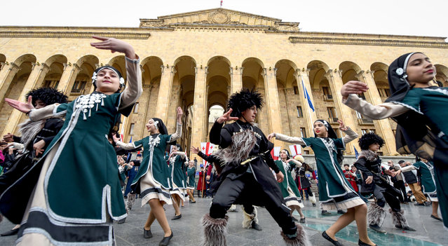 "Georgian children dance during a rally to commemorate the 30th anniversary of the so-called ""Tbilisi tragedy"" as they mark the Day of National Unity in Tbilisi, on April 9, 2019. (Photo by Vano Shlamov/AFP Photo)"