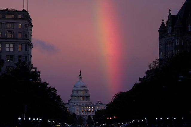 A rainbow forms over the U.S. Capitol as evening sets on midterm Election Day in Washington, November 6, 2018. (Photo by Jonathan Ernst/Reuters)