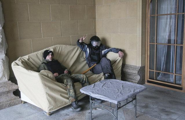 Protesters relax at the Ukrainian President Yanukovych's countryside residence in Mezhyhirya, Kiev's region, Ukraine, Saturday, February 22, 2014. (Photo by Efrem Lukatsky/AP Photo)