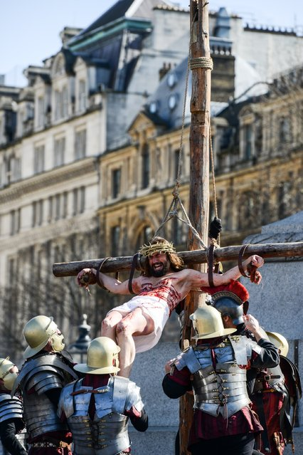 "Actor James Burke-Dunsmore is raised on to a crucifix whilst playing Jesus during The Wintershall's ""The Passion of Jesus"" in front of crowds on Good Friday at Trafalgar Square on March 25, 2016 in London, England. (Photo by Chris Ratcliffe/Getty Images)"