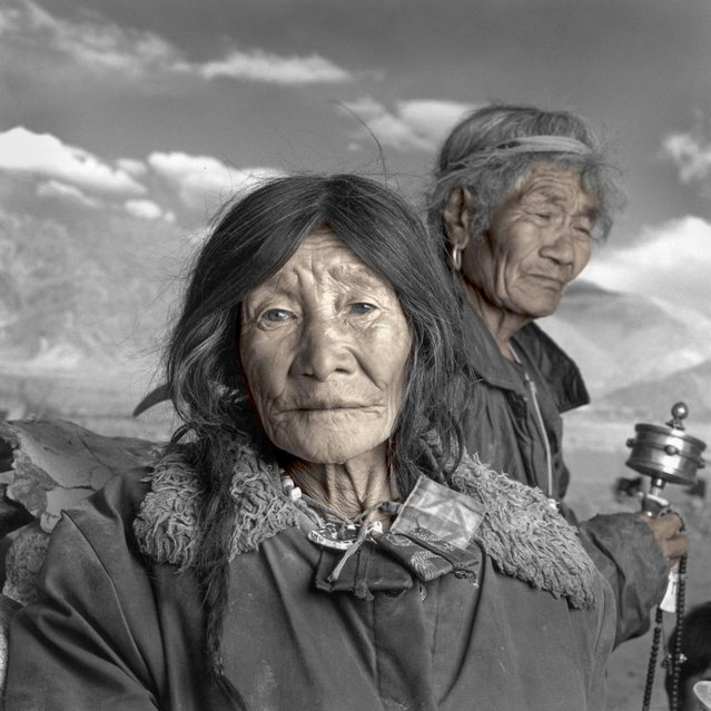 """Botok and Tsangpa were classified as wealthy by the Communist authorities in 1962 because they owned almost 1,000 sheep and goats. Threatened with imprisonment, they fled across the border into the Indian state of Ladakh with their three daughters and her other husband. They told me that it is not uncommon for Tibetan women to take more than one husband"". (Phil Borges)"