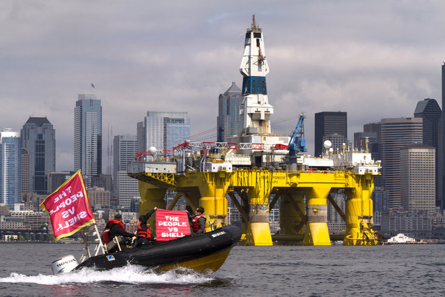 Environmental activists protest the arrival of the Polar Pioneer, an oil drilling rig owned by Shell Oil, on May 14, 2015 in Seattle, Washington. The rig is part of a fleet that will lead a controversial oil-exploration effort off Alaska's North Slope. (Photo by Karen Ducey/Getty Images)
