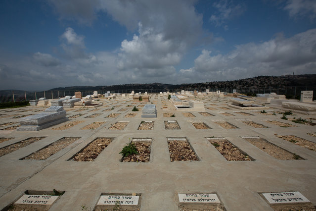 Reserved burial plots with the names of the people which they are reserved for, are seen at the Givat Shaul cemetery, on May 14, 2015, in Jerusalem, Israel. (Photo by David Vaaknin/The Washington Post)