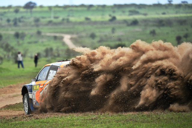 Kenya's Manvir Baryan and his British navigator Drew Sturrock kick up a dust cloud in the Skoda Fabia R5 as he negotiates a turn on July 6, 2019, during the second day of the safari rally at Soysambu ranch near Kenya's lakeside town of Naivasha. The Safari rally was started as an east African competition between Kenya, Uganda and Tanzania to celebrate the coronation of Britain's Queen Elizabeth II in 1953. In 2003 it was dropped off the world circuit due to concerns over safety, organization and finances. (Photo by Tony Karumba/AFP Photo)