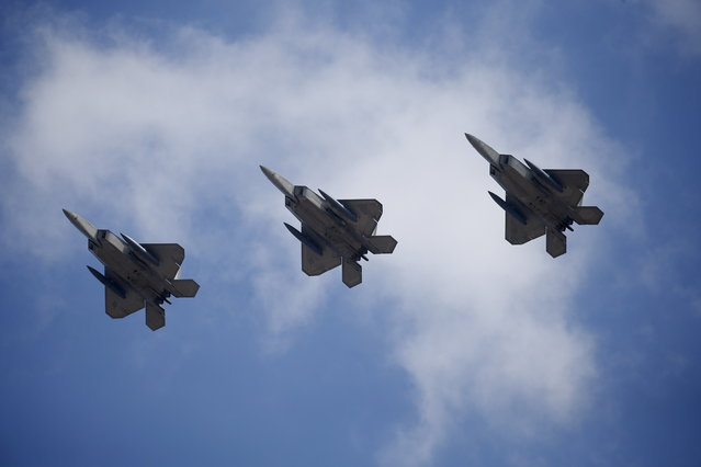 U.S. F-22 stealth fighter jets fly over Osan Air Base in Pyeongtaek, South Korea, February 17, 2016. (Photo by Kim Hong-Ji/Reuters)