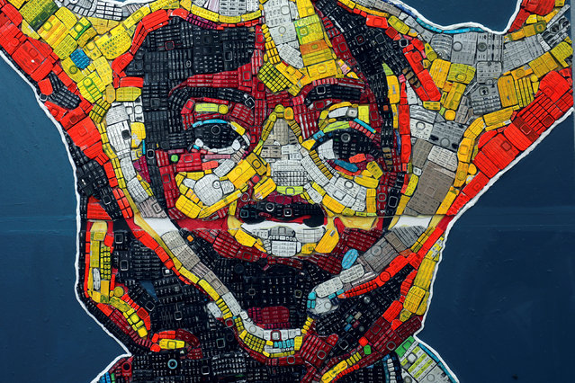 An artwork created with discarded phone keyboards is pictured at the workshop of 24-year-old artist Desire Koffi, in Abidjan, Ivory Coast December 3, 2018. (Photo by Luc Gnago/Reuters)