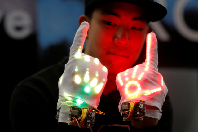"An employee demonstrates the Groove, ""a wearable glove device that enhances the dancer's expression"", at the Trade Show at the South by Southwest (SXSW) Music Film Interactive Festival 2017 in Austin, Texas, U.S., March 13, 2017. (Photo by Brian Snyder/Reuters)"