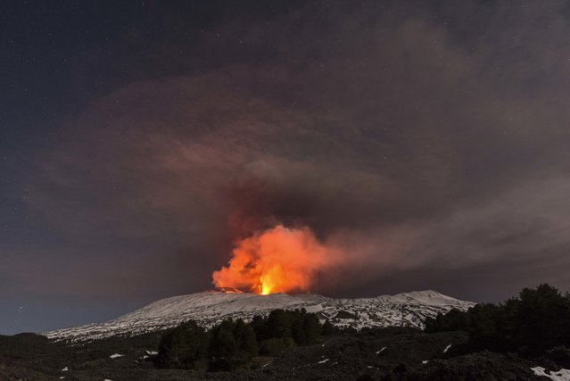 Snow-covered Mount Etna, Europe's most active volcano, spews lava during an eruption in the early hours of Thursday, March 16, 2017. (Photo by Salvatore Allegra/AP Photo)