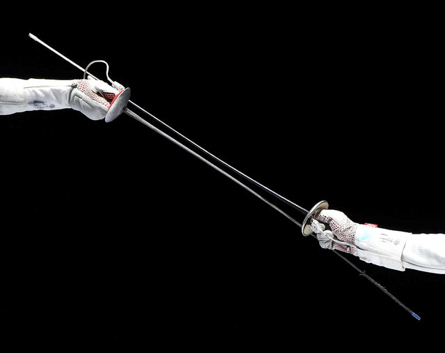 Lee Kiefer, left, of the US fights against Anita Blaze of France during the third place match for the women's foil team competition of the FIE World Fencing Championships in Budapest, Hungary, Monday, July 22, 2019. (Photo by Balazs Czagany/MTI via AP Photo)