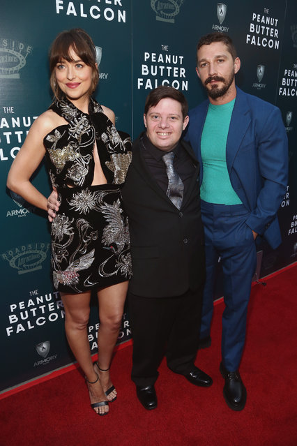 """Dakota Johnson, Zack Gottsagen and Shia LaBeouf attend the LA Special Screening Of Roadside Attractions' """"The Peanut Butter Falcon"""" at ArcLight Hollywood on August 01, 2019 in Hollywood, California. (Photo by Tommaso Boddi/Getty Images)"""