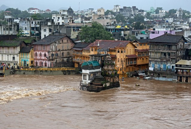 Houses and temples are seen submerged in the waters of overflowing river Godavari after heavy rainfall in Nashik, India, August 5, 2019. (Photo by Francis Mascarenhas/Reuters)