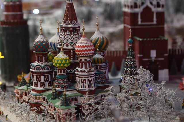 A miniature model of St. Basil's Cathedral on Red Square in Moscow, part of Gulliver's Gate, a miniature world being recreated in a 49,000-square-foot exhibit space in Times Square, is seen during a preview April 10, 2017 in New York City. (Photo by Timothy A. Clary/AFP Photo)