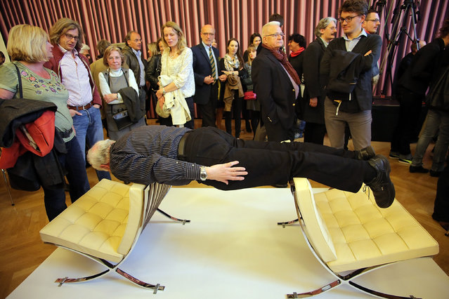 """Visitor performes during the Erwin Wurm """"One Minute Sculpture Exhibition"""", at the Staedel Museum on May 6, 2014 in Frankfurt am Main, Germany. (Photo by Hannelore Foerster/Getty Images)"""