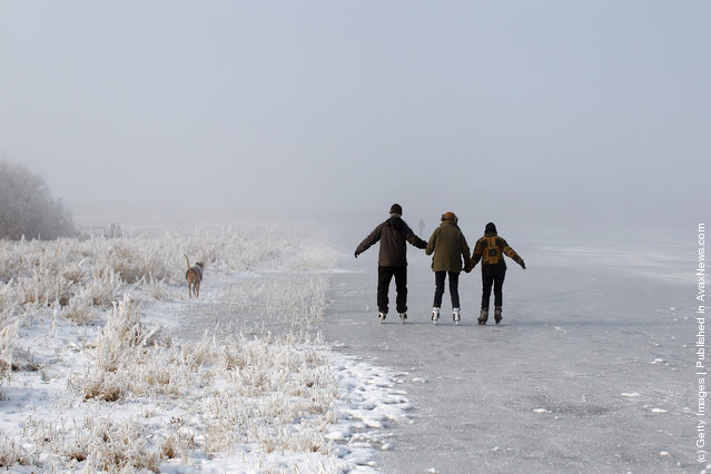 Enthusiasts skate on a frozen fen in sub-zero temperatures