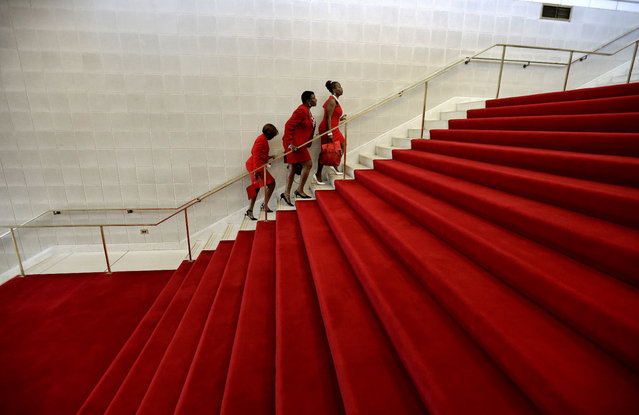 Members of Delta Sigma Theta Sorority, Inc. climb the red-carpeted stairs at the North Carolina General Assembly in Raleigh, N.C., Wednesday, May 3, 2017. The Sorority visits the legislature annually to voice their concerns to lawmakers. In 1913, the founders of Delta Sigma Theta performed their first public act by participating in the Women's Suffrage March in Washington, D.C. (Photo by Gerry Broome/AP Photo)