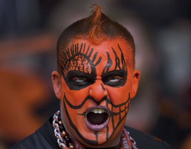 A BC Lions fan cheers for the team during their during their CFL football game against the Toronto Argonauts in Vancouver, British Columbia, July 24, 2015. (Photo by Andy Clark/Reuters)