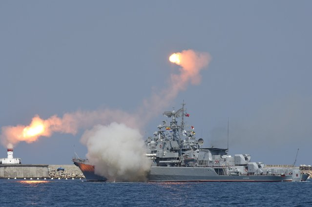 A Russian warship fires during celebrations for Navy Day in the Black Sea port of Sevastopol, Crimea, July 26, 2015. (Photo by Pavel Rebrov/Reuters)