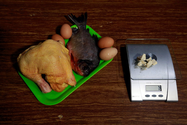 Chicken, fish and eggs lie next to coca paste worth $14,000 Colombian pesos at a local store in Guyabero Region, Guaviare, Colombia, May 24, 2016. (Photo by John Vizcaino/Reuters)