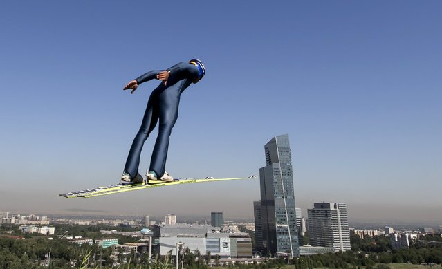 A skier soars through the air during training session at the Sunkar Ski Jumping complex in Almaty, Kazakhstan, July 15, 2015. (Photo by Shamil Zhumatov/Reuters)