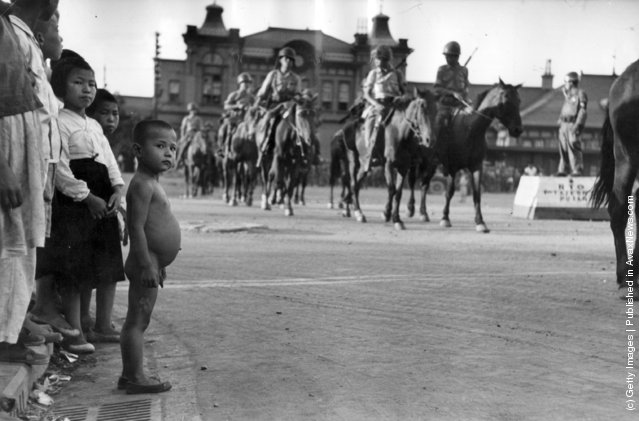South Korean Cavalry troops forming up in a street in Taegu, before being transported to the front, 1950