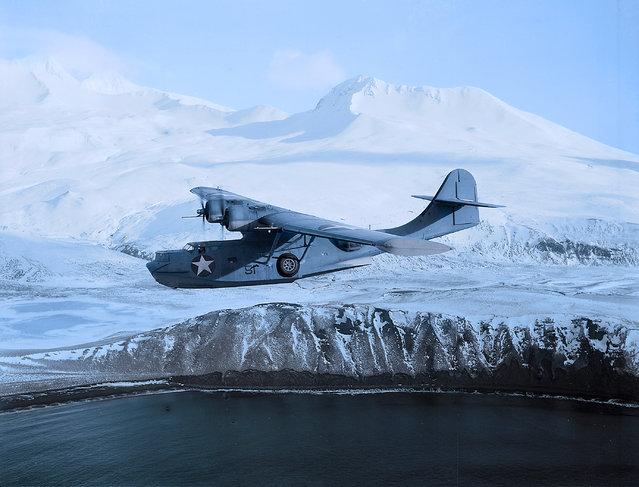 A US PBY-5 Catalina flying boat soars over a Pacific island. (Photo by Jared Enos/Mediadrumworld.com)