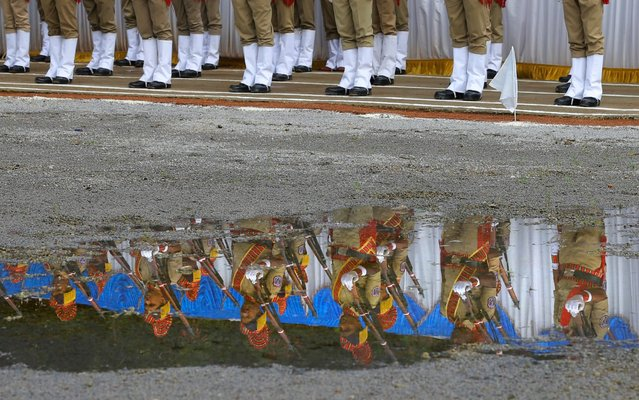 Indian policemen pay homage on Police Commemoration Day in Hyderabad, India, Monday, October 21, 2019. Police Commemoration Day is observed on Oct. 21 every year to honor the courage and commitment of policemen who laid down their lives in the execution of their official duty for the country. (Photo by Mahesh Kumar A./AP Photo)