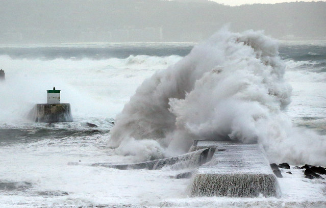 A wave hits the seawall at Saint Jean de Luz, southwestern France, Monday, December 9, 2019. (Photo by Bob Edme/AP Photo)