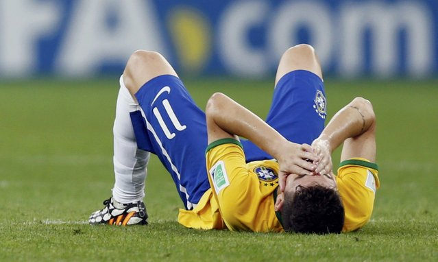 Brazil's Oscar reacts after their loss to Germany in their 2014 World Cup semi-finals at the Mineirao stadium in Belo Horizonte July 8, 2014. (Photo by Marcos Brindicci/Reuters)