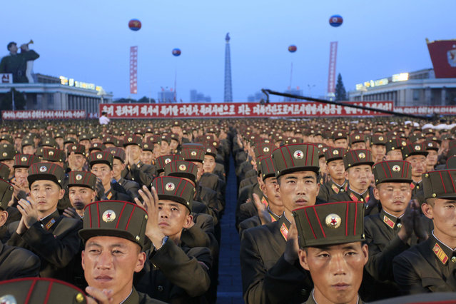 Soldiers gather in Kim Il Sung Square in Pyongyang, North Korea,Thursday, July 6, 2017, to celebrate the test launch of North Korea's first intercontinental ballistic missile two days earlier. The North's ICBM launch, its most successful missile test to date, has stoked security worries in Washington, Seoul and Tokyo as it showed the country could eventually perfect a reliable nuclear missile capable of reaching anywhere in the United States. Analysts say the missile tested Tuesday could reach Alaska if launched at a normal trajectory. (Photo by Jon Chol Jin/AP Photo)