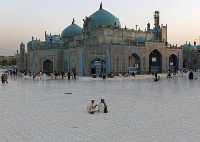 Men sit in the yard of the shrine of Imam Ali, son in-law of Prophet Mohammad, in the city of Mazar-i-Shariff, northern Afghanistan, July 29, 2015. (Photo by Mohammad Ismail/Reuters)