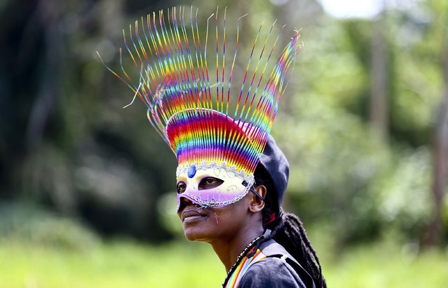 A woman wears a mask while celebrating the annulment of an anti-homosexuality law by Uganda's constitutional court in Entebbe August 9, 2014. Last week, the east African country's constitutional court nullified the anti-homosexuality law, signed by President Yoweri Museveni in February, on a technicality, saying it had been passed by parliament without quorum. (Photo by Edward Echwalu/Reuters)